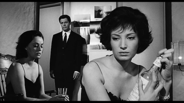 a still of Jeanne Moreau, Marcello Mastroianni, and Monica Vitti together in La notte